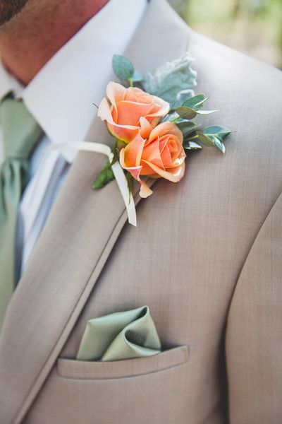 Mint + peach groom outfit idea - tan suit with mint pocket square + orange spray rose boutonniere with mint necktie {Emily Joanne Wedding Films & Photography}
