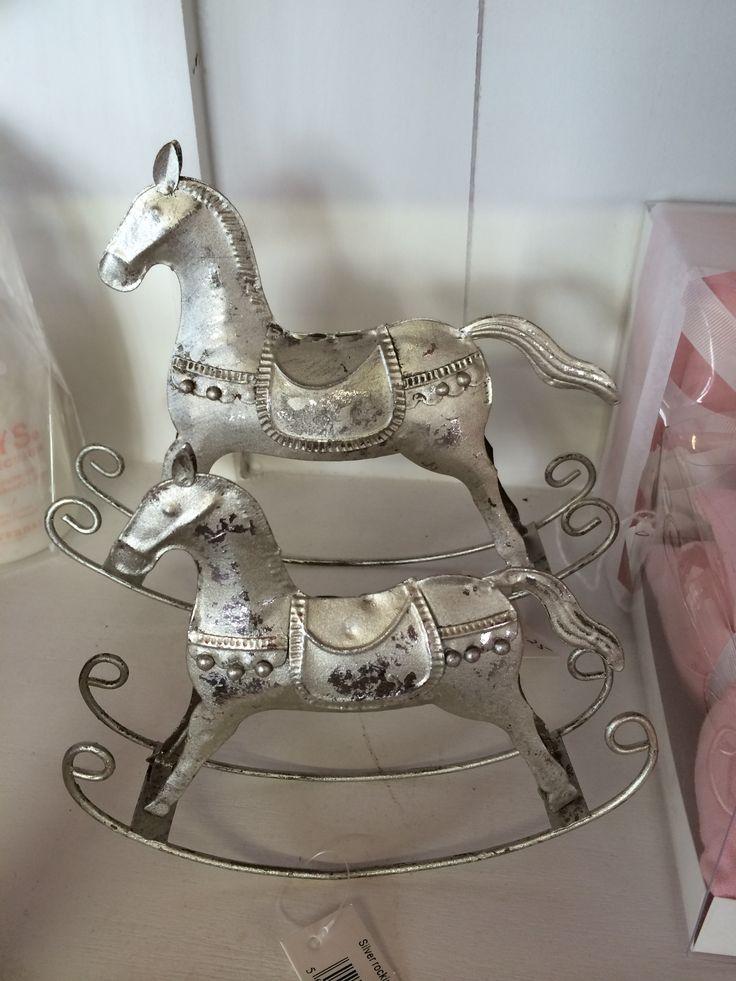 Different sized decorative rocking horses
