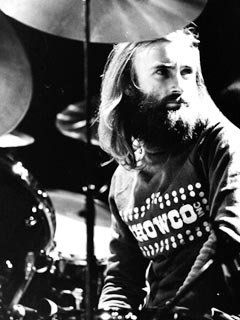 Genesis Band | ... with British rock band Genesis, takes a break behind his drumkit