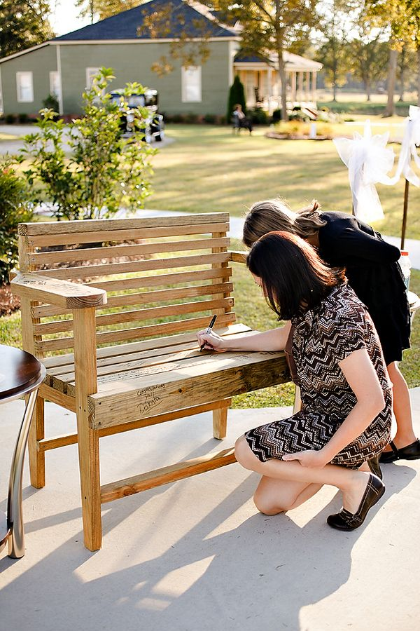 Use a wooden bench as a guestbook to keep in your home forever...... be sure to poly it before sitting on it!