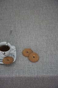 a cofee with POEMO DESIGN's tablecloth