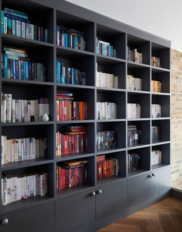 Modern home office with floor-to-ceiling shelving