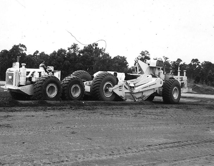 Not too small for the big jobs, this C Tournatractor is seen here push loading another of the company's products, a model B-70 motor scraper. In the right underfoot conditions the C Tournatractor was an excellent push dozer. This machine is equipped as a dedicated push tractor