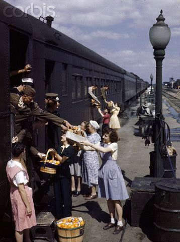 Farm women give gifts of food to service men traveling by train (North Platte, Nebraska, USA)