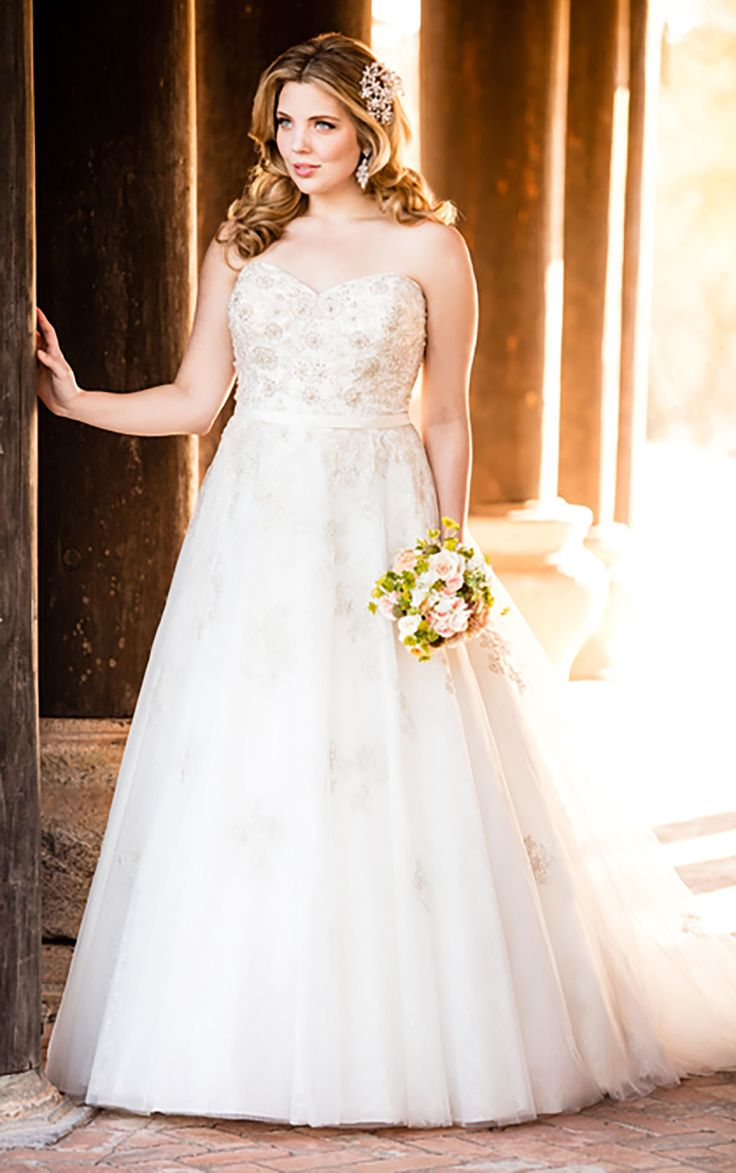 From the Stella York wedding dress collection comes this gorgeous silver Lace and Tulle gown featuring hand-beaded details. #weddingdresses #SoStella