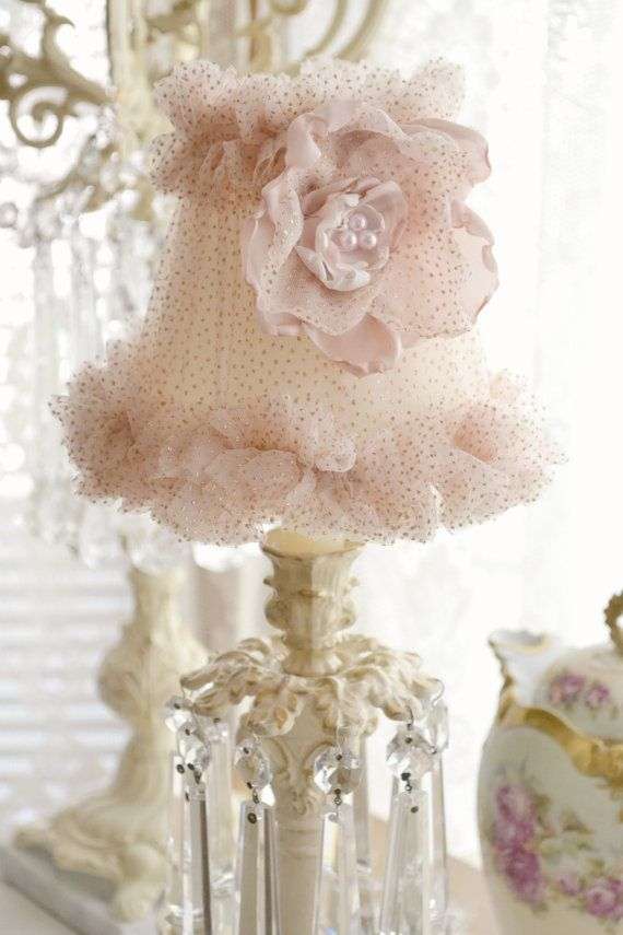 This listing is for one gorgeous small lampshade embellished by Jennelise Rose. Covered in beautiful blush coloured tulle with gold sparkles and