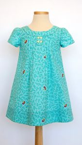 This little dress is so adorable! I want to make a few! The pattern comes in two sizes. 6M-4 and 5-12.