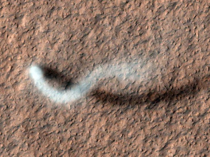 The Serpent Dust Devil of Mars by NASA: Image by the High Resolution Science Experiment camera on NASA's Mars Orbiter (HiRISE), this dust devil was shot on a late spring afternoon in northern Mars and measures more than 1/2 mile in height. #Dust_Devil #Mars #NASA