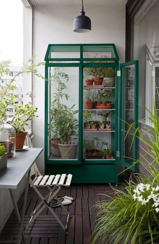 A little greenhouse adds a gorgeous and practical element to this small outdoor space. The balcony still has space for sitting and relaxing in addition to space for this greenhouse!