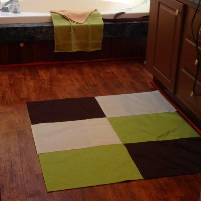 Bathroom rug made from 6 placemats from the dollar tree. Duct tape on the back and non-slip rug underlay underneath. $8 rug!!!