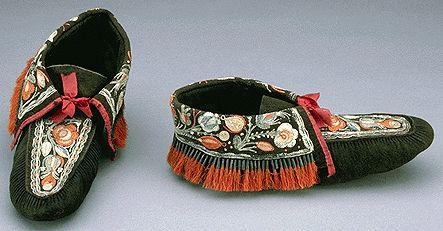 1830 Huron-Wendat Moccasins at the Canadian Museum of Civilization, Gatineau - The Huron-Wendat were an Iroquoian First Nations people that, in the 17th century, established a trade and military alliance with the French along with their Algonquian allies against the other Iroquois.  However, in the 17th century, they were driven from their homeland in what is now Ontario by the Iroquois (who were given guns by the Dutch) and resettled in the current province of Quebec, most notably in…