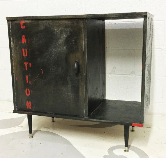 industrial media cabinet with one door and heavy texture hand painted