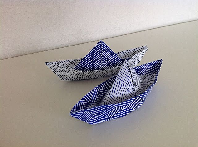 Bellas bedrifter: Origami-både...