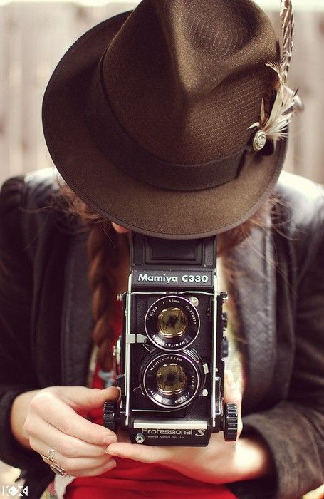 Fedora and old camera. Perfect