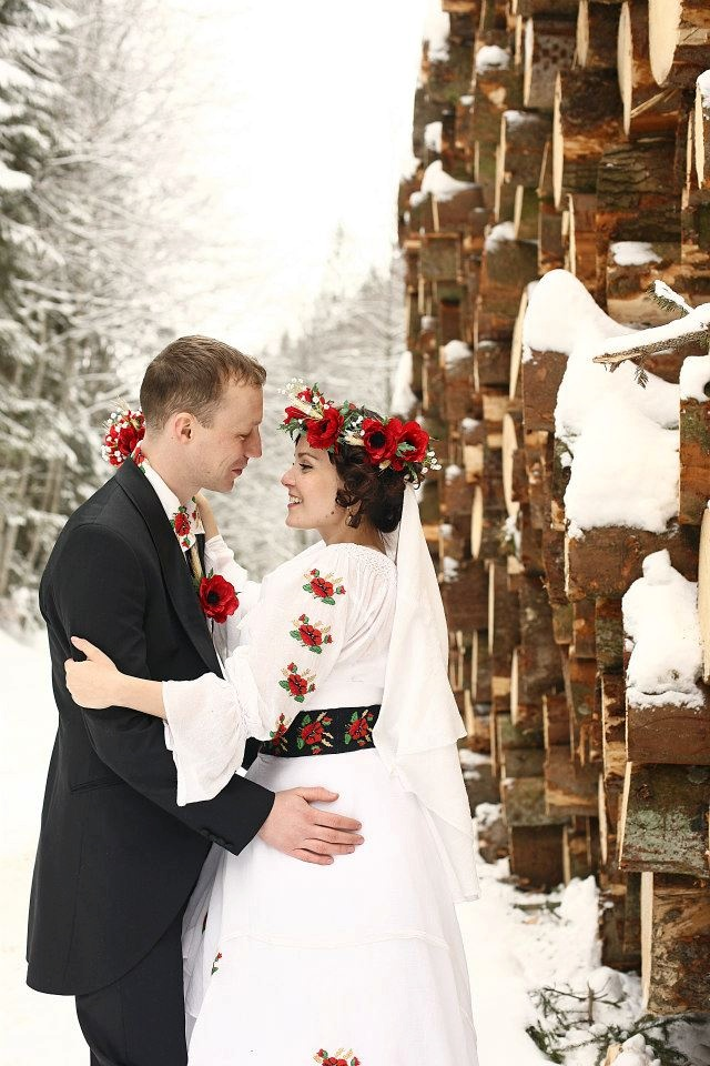 "Winter Rustic Wedding, Poppy wedding theme, the bride is wearing a traditional Romanian hand embroidered blouse called ""ie"", and the groom is wearing a shirt with the same poppy embroidery pattern. The headpiece and bouquet are also made of poppies.   People, Cultures, Emotions"