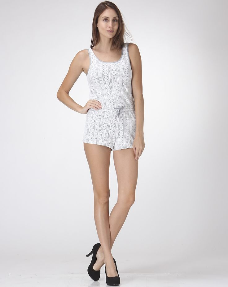 This very dainty short jumpsuit is made of tribal lace. It has drawstrings at the waist to make adjust fit. It has rounded neck.
