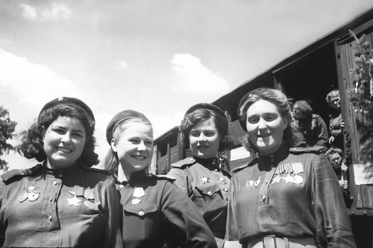 Bemedalled female snipers of the Red Army wear broad smiles as they prepare to return home after the end of the war, May 1945.