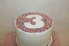 Gorgeous sprinkle cake at a 3rd birthday party!  See more party ideas at CatchMyParty.com!