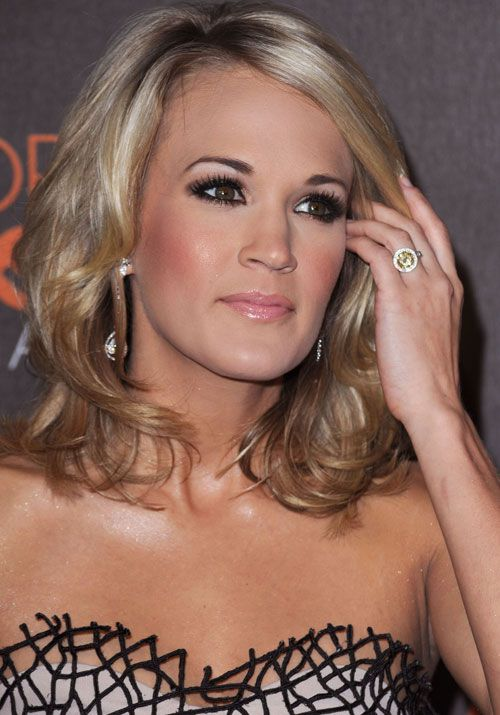 Carrie Underwood's stunning engagement ring from Mike Fisher. LOVE! Minus the yellow stone :)