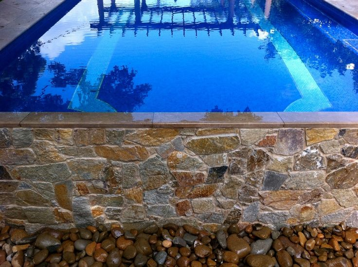 Stone waterfall from pool in Hunters Hill, Sydney @Eco Outdoor Sports #coolumstone #stonecladding #masonry #waterfeature #pooldesign #landscapedesign #stone