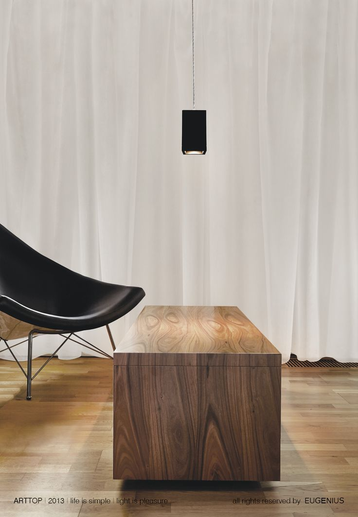 EUGENIUS. modern lighting fixtures, architectural interior lamps for home and office. wooden table and floor with modern, black armchair give you an idea how to combine simple, contemporary shapes with warm interior. our lamps can be use in many different arrangements, everything depends on your idea :)