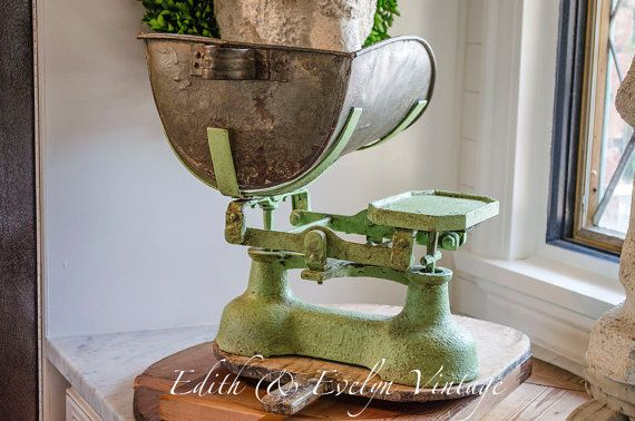 Amazing antique balance scale. Ah-mazing! Im in love with this antique merchants scale. It has a wonderful, old, chippy green finish, and the most amazing galvanized scoop pan that Ive ever seen. I think this must have come out of a General or Feed store due to the size of the pan and it being a scoop design. It is a balance type scale and also has three of the original cast iron weights, 4 lb, 2 lb, and 1 lb size. The scale itself measures 8 tall x 12.5 wide. Measurements with the pan…