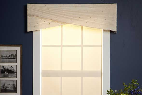 Simple Cornice with window shade interesting --Could you do this with a sheer or light linen