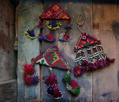 Triangles are one of the most powerful amuletic shapes in the West Asian, North African region. The shape is used in amulets or as decorative patterns in embroidery. Sometimes the triangles are made of textiles, sometimes of leather or even beadwork.