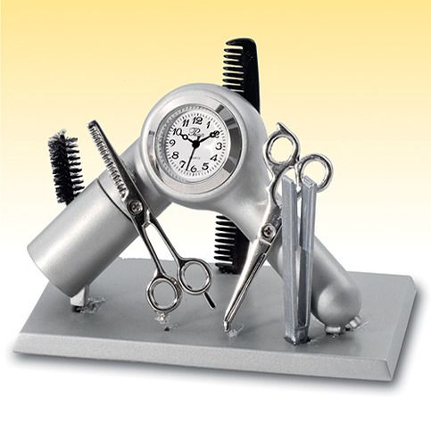 Hair stylists clock makes a great gift for your favorite salon professional or barber. Ideal to use at work to keep track of time during appointments. Clever design depicts stylists' favorite tools: scissors, comb, brush, flat iron and hair dryer. Requires one button cell battery, included. Metal...