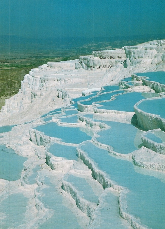 Pamukkale - Turkey - ONE of my favorite visits. What looks like a winter wonderland is actually a summer landscape with hot springs, crusted with calcium deposits. Pamukkale, in south western Turkey, is a natural mineral-bath spa first built by the Romans around a sacred hot spring and still open to the public as the Sacred Pool today.