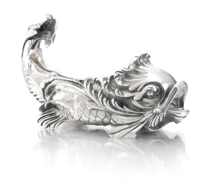A Fabergé silver salt, Moscow, circa 1890 modelled as a dolphin, struck K. Fabergé in Cyrillic beneath the Imperial Warrant, 88 standard, scratched inventory number 4258