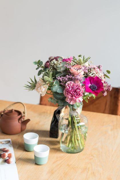 Bouquet de fleurs dans les tons de rose