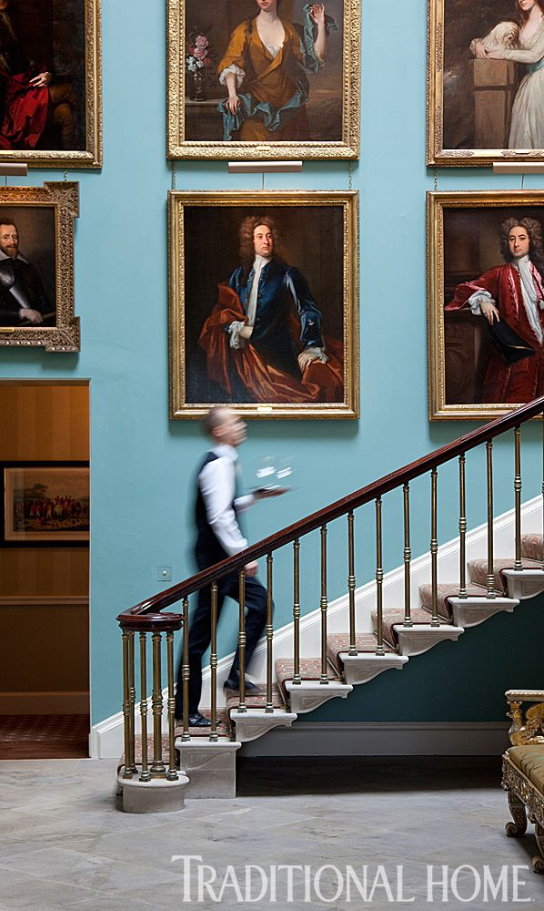 An impressive gallery of family portraits resides along the stairwell wall. - Photo: Karyn Millet