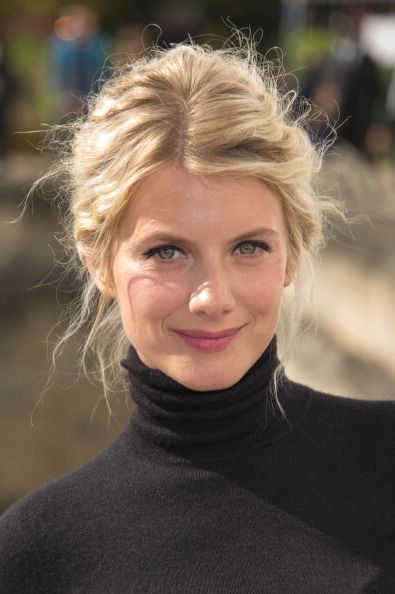 I'd love to leave my hair like this but on my, it's unkempt looking. Maybe I must be famous to get away with it?    French actress Mélanie Laurent arriving at the Dior Spring/Summer 2013 show in Paris