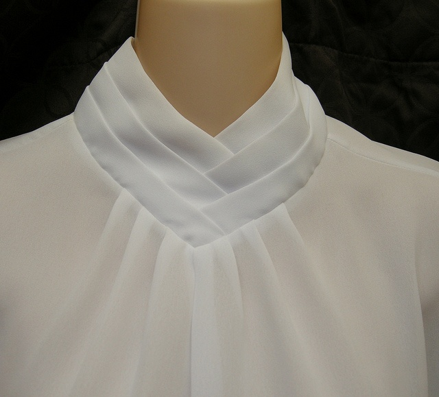 High neck would not look good on me but these layers of fabric would be awesome on a V-neck T.