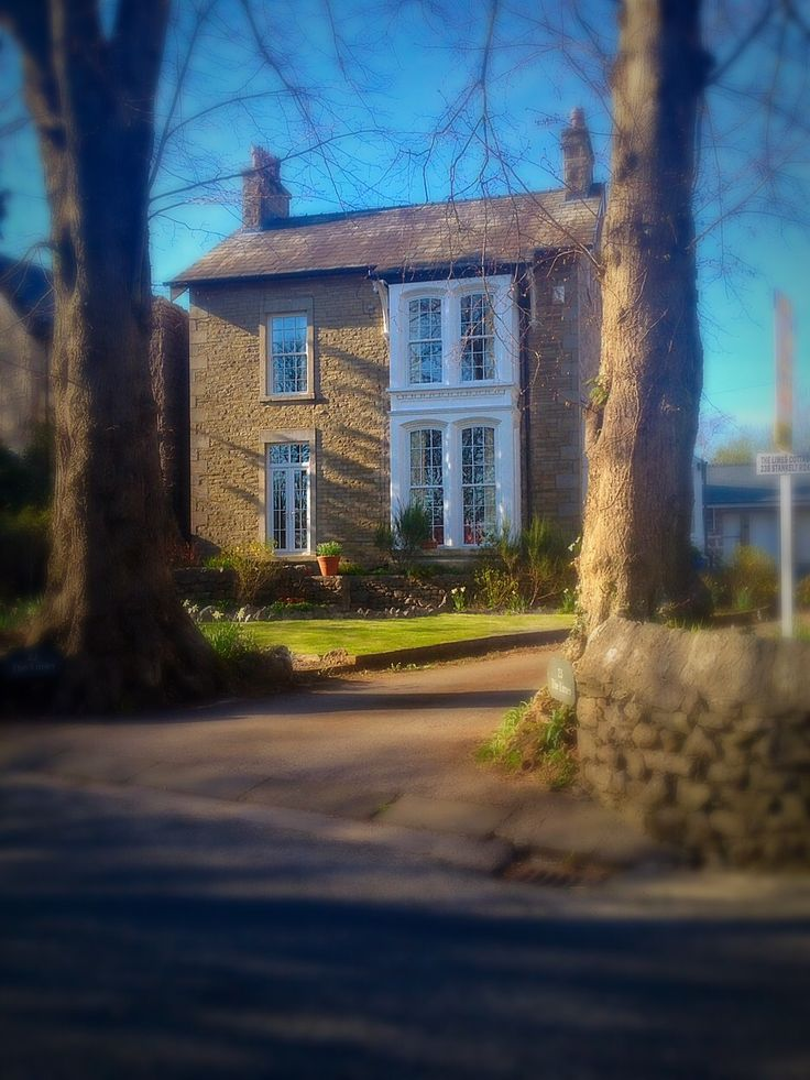White double height bay window to match white door - Silverdale, England