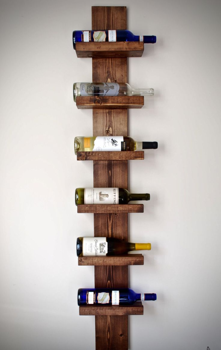 Rustic Wine Rack, Vertical Wine Rack, Rustic Modern Wine Rack by DynastiMillworks on Etsy https://www.etsy.com/listing/259670623/rustic-wine-rack-vertical-wine-rack