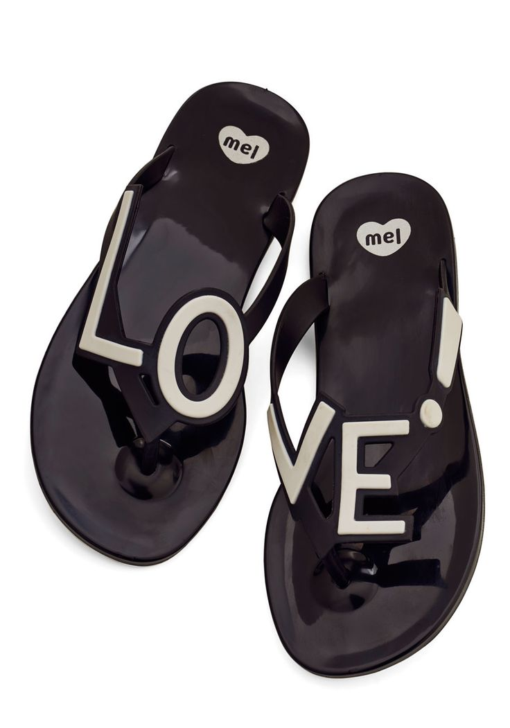 Stylish Expression Sandal. Exhibit your adoration for fashion each time you step into these black flip flops by Mel Shoes.Dedicated to vegan-friendly, thoughtful, fantastically girly designs, Mel Shoes creates sweetly scented, soft plastic footwear thats as comfy as it is cute! #black #modcloth