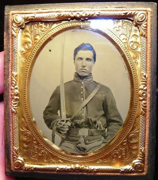 an exceptional sixth plate clear glass ambrotype of a triple armed Union cavalry soldier.  He is sporting his sword and what looks like two Colt revolvers.  The image is pretty much mint and comes in a split leather case.