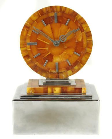 An Art Deco bakelite and chromed metal mantel clock