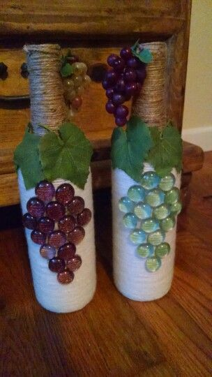Made these for my sister in law :-) Took a wine bottle, wrapped it in white yarn, then wrapped twine for the top and glued flat gems and leaves on