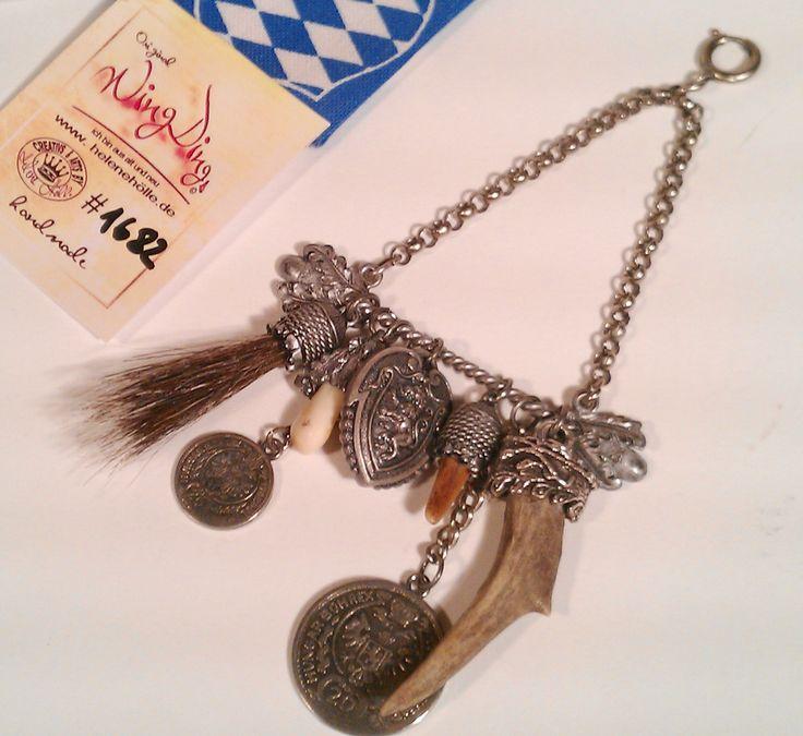 #Dirndl Charivari nr.1682-A, #Rockstecker     Schönes Unikat - handmade    # Charivari #Trachtenschmuck    # Charivari Fassungen aus Zinn     mit #Krickerl und #Hornspitze in #Zinnfassungen    # bayrischer Löwe     mit alten #Münzen     Mit #Dachsbart     alles an schön geformten Zinnträger     mit 2 #Grandeln schön gefasst #Geweihstück schön und präzise in #Zinfassungen eingearbeitet UNIKAT Schmuck handmade by #helenehoelle.de