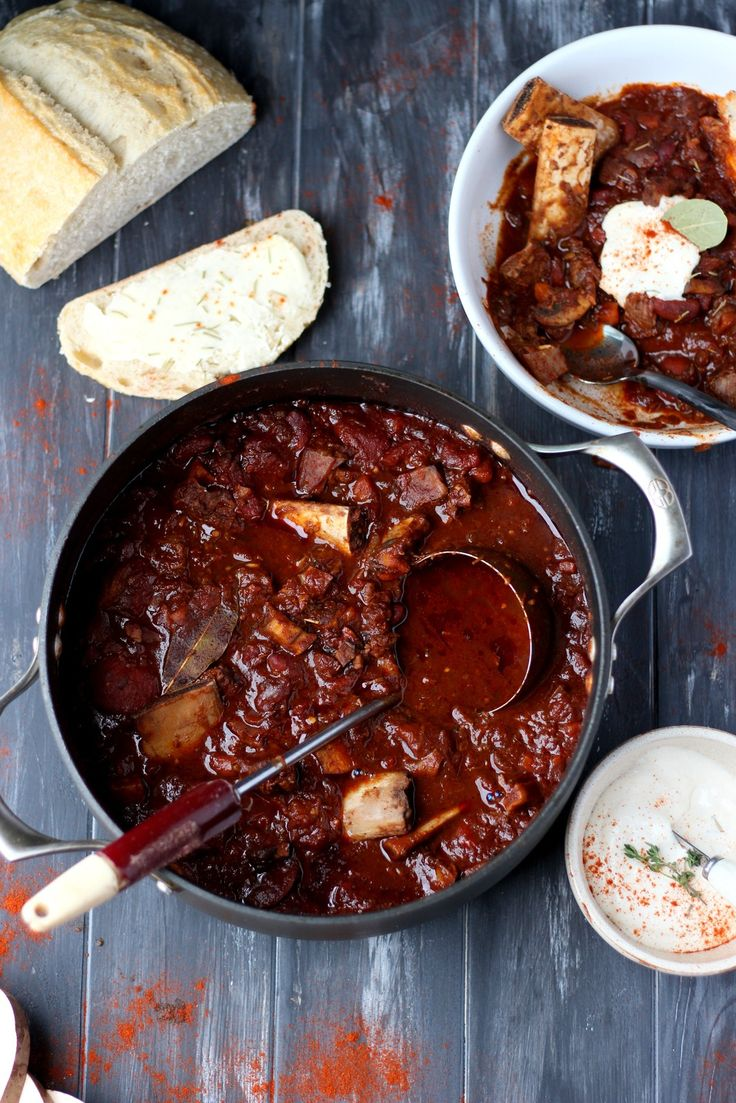 Braised Beef Shortrib Chili + Horseradish Sour Cream - amazing chili recipe that combines braised short ribs with your classic chili flavors.  Such a unique and flavorful chili recipe with mushrooms, leeks, whole tomatoes and fennel.  thewoodenskillet.com #foodphotography #foodstyling