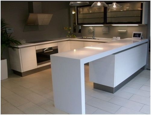 This kitchen is from the SL101 range by SieMatic. The doors are finished in an Ecru Pine Horizontal Laminate and Obsidian glass with a stainless steel plinth. The worktops are 40mm and 80mm Blanco Zeus Silestone.     Also included in the sale is a wealth of top of the range Miele appliances. There is ample storage including a magic corner and all drawers have soft close mechanisms. in excess £40000