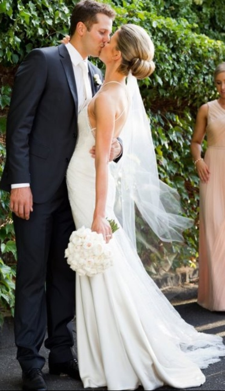 Courtney wearing a beautiful Jane Hill Wedding Gown in champagne silk with a high cut away neckline in ivory French lace