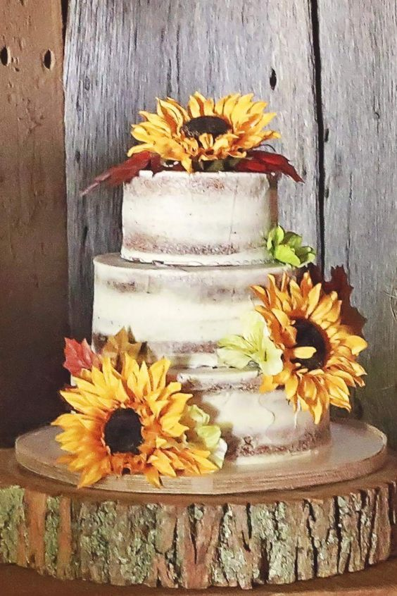 Half naked wedding cake with sunflowers / http://www.himisspuff.com/country-sunflower-wedding-ideas/13/