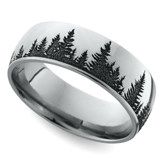 This domed men's wedding band features a serene pine forest pattern laser carved into cobalt for a unique look.