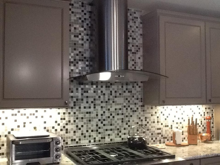 A custom backsplash designed to match cambria's Praa Sands