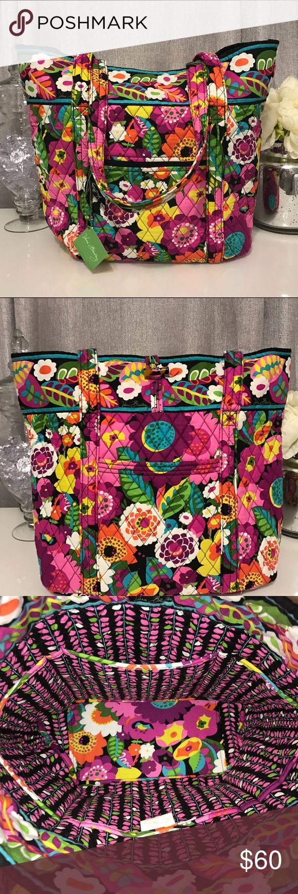 NWT Vera Bradley Tote Bag Va Va Bloom This Vera Bradley tote is in the pattern Va Va Bloom. It has never been used with tags still attached! Large slip pocket in the front, zip pocket in the back, and six slip pockets inside! Feel free to make offers! Vera Bradley Bags Totes