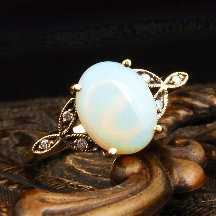 The opal is my favorite stone.  I have one opal ring that I can no longer wear due to the arthritic damage to my hands.  What's with this aging thing anyhow?